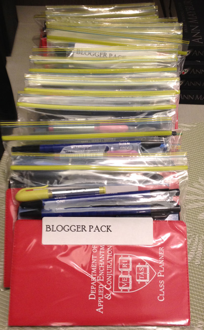 """The swag packs I prepped for the bloggers at the blogger party. My pens say """"Keep Calm and Write On"""" on them, and yes, those are Magic University class planners!"""