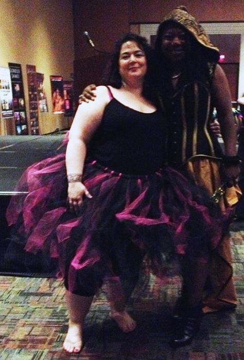 Sasha White rocking the crinoline and TJ Michaels in a super-amazing corset with hood ensemble.