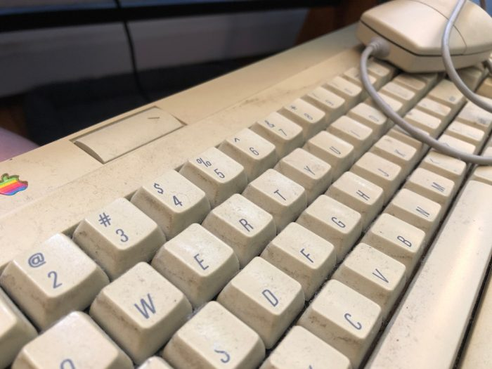 Ancient, grimy-looking Mac keyboard from the 1990s.